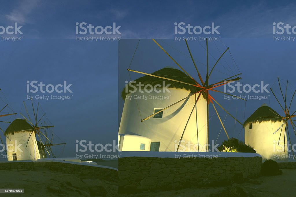 Mykonos windmills at night, Cyclades Islands, Greece royalty-free stock photo