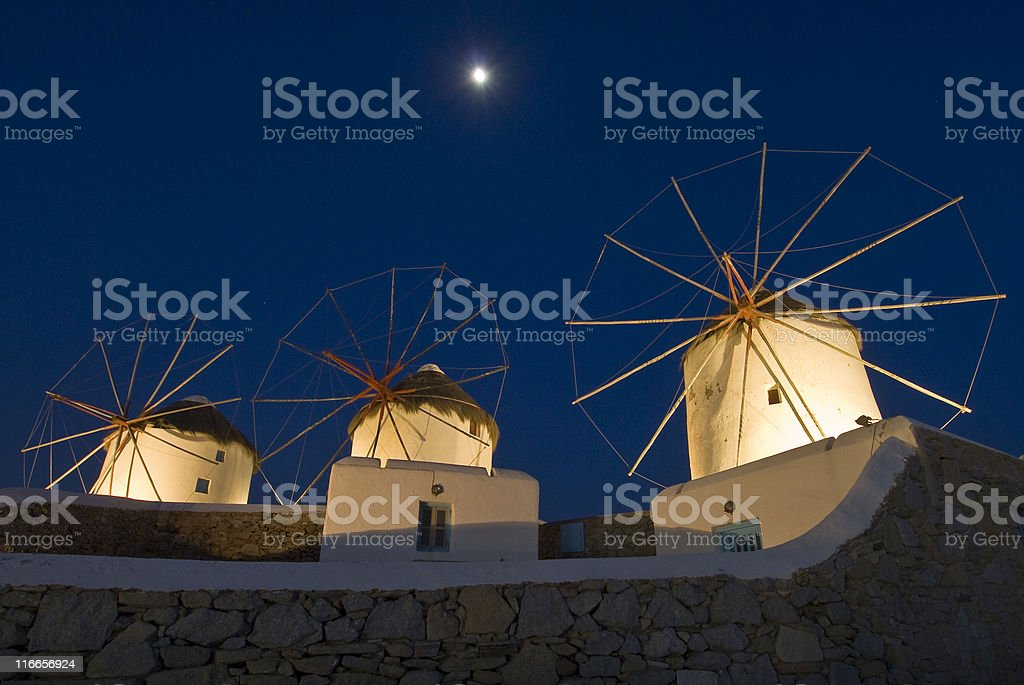 Mykonos windmills, full moon and blue evening sky, Greece royalty-free stock photo
