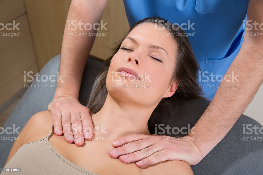 myofascial therapy on beautiful woman shoulders royalty-free stock photo