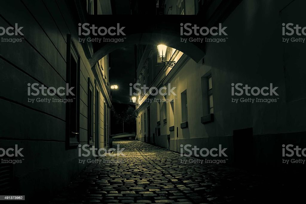mysterious alley with lanterns in Prague at night stock photo