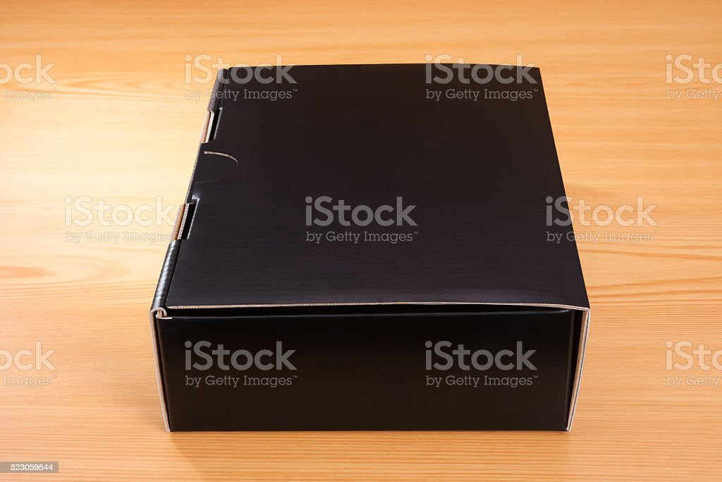Mysterious black box on wood background stock photo