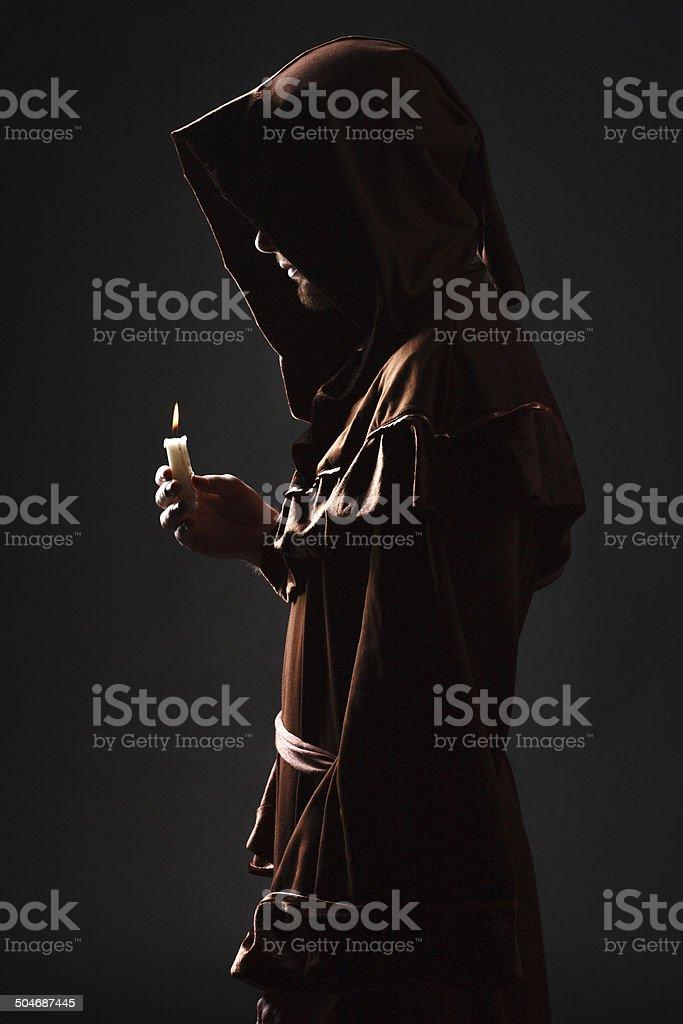 mysterious Catholic monk stock photo