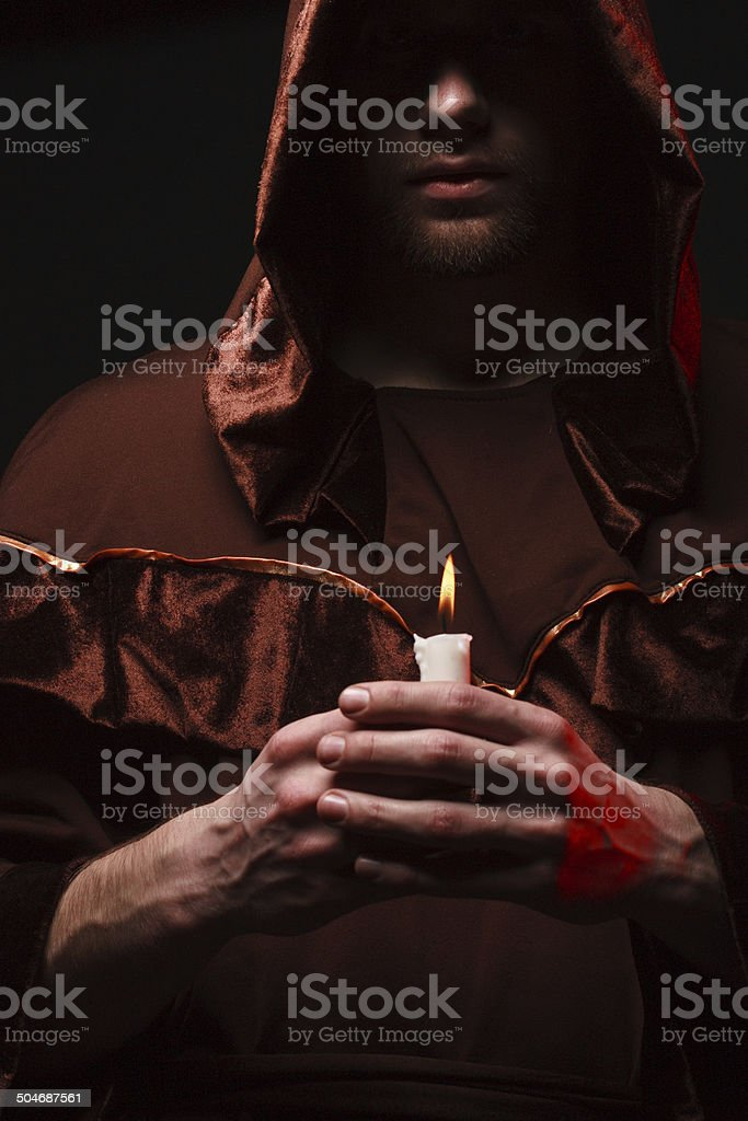mysterious Catholic monk stock photo