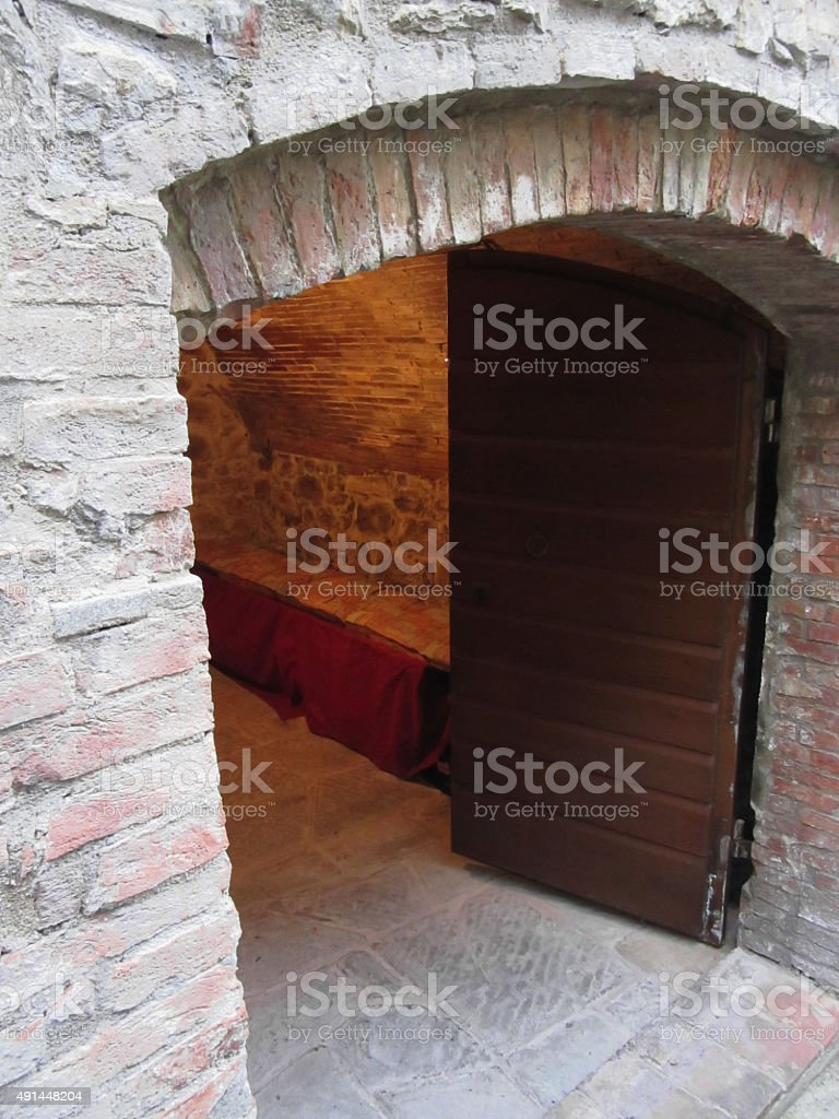 Mysterious door, secret entrance with warm light inside stock photo