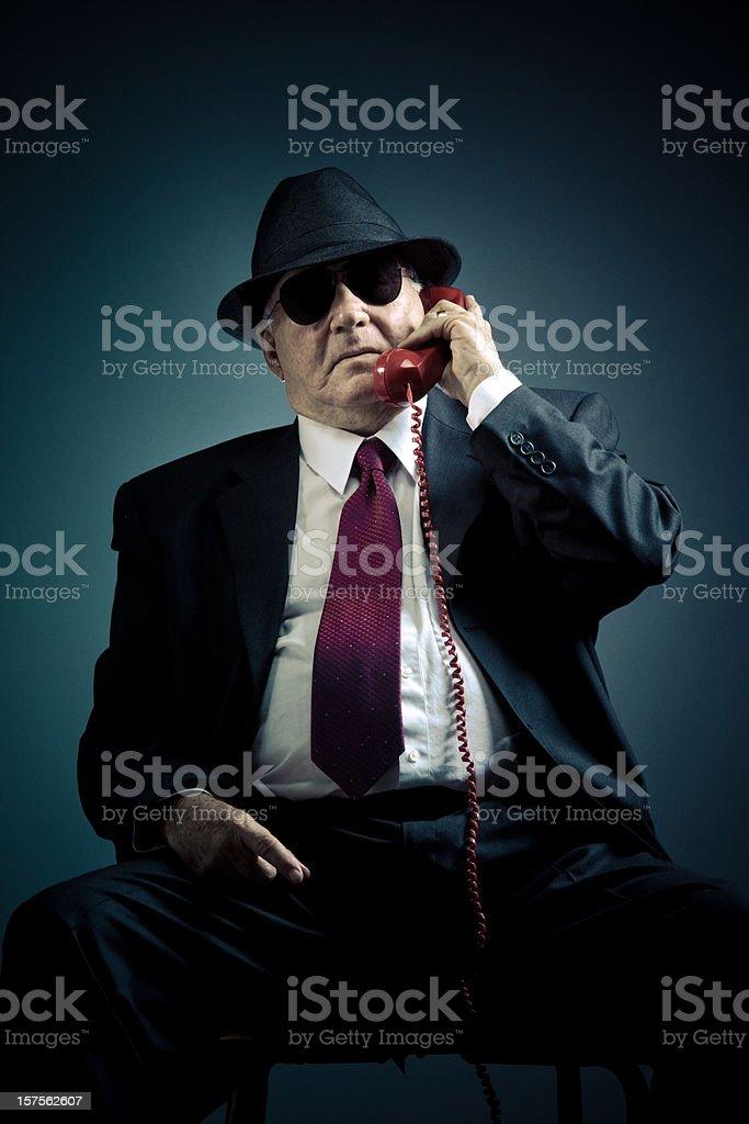 mysterious elegant senior on a phone call stock photo
