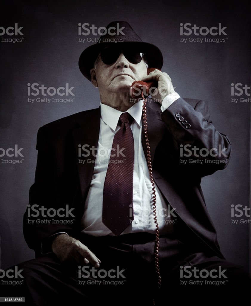 mysterious elegant senior on a phone call stock photo