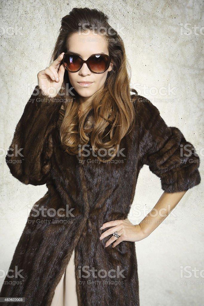Beautiful fashionable woman in elegant fur