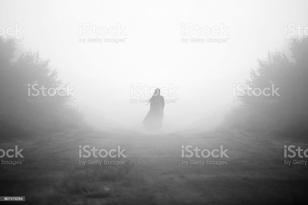 Mysterious Girl in the Fog Black and White stock photo