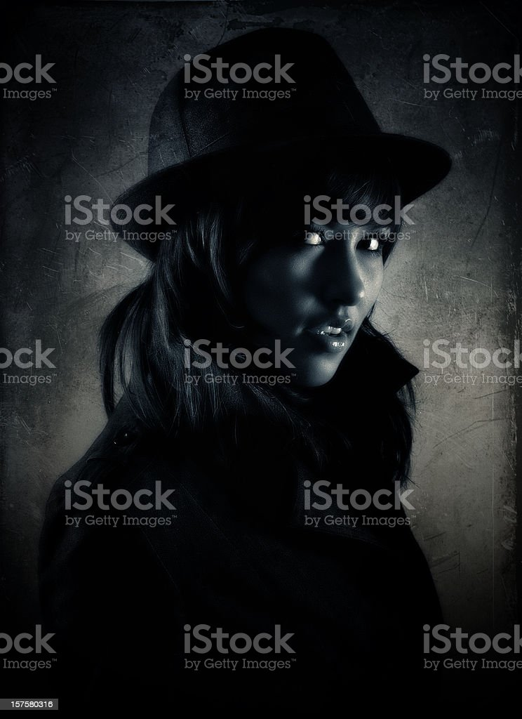 mysterious girl wearing black clothes, hat and gabardine stock photo