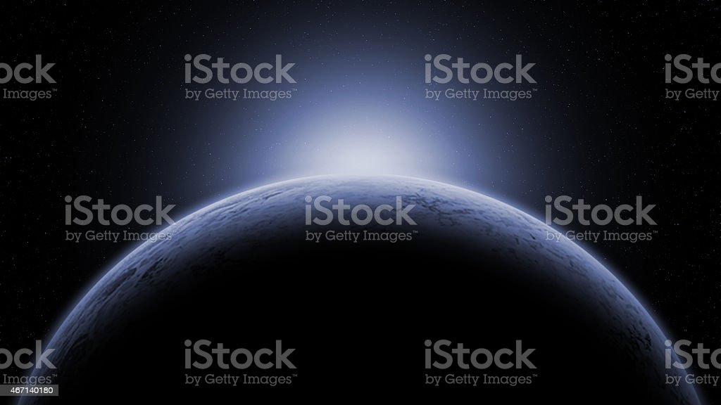 Mysterious ice planet against star field stock photo