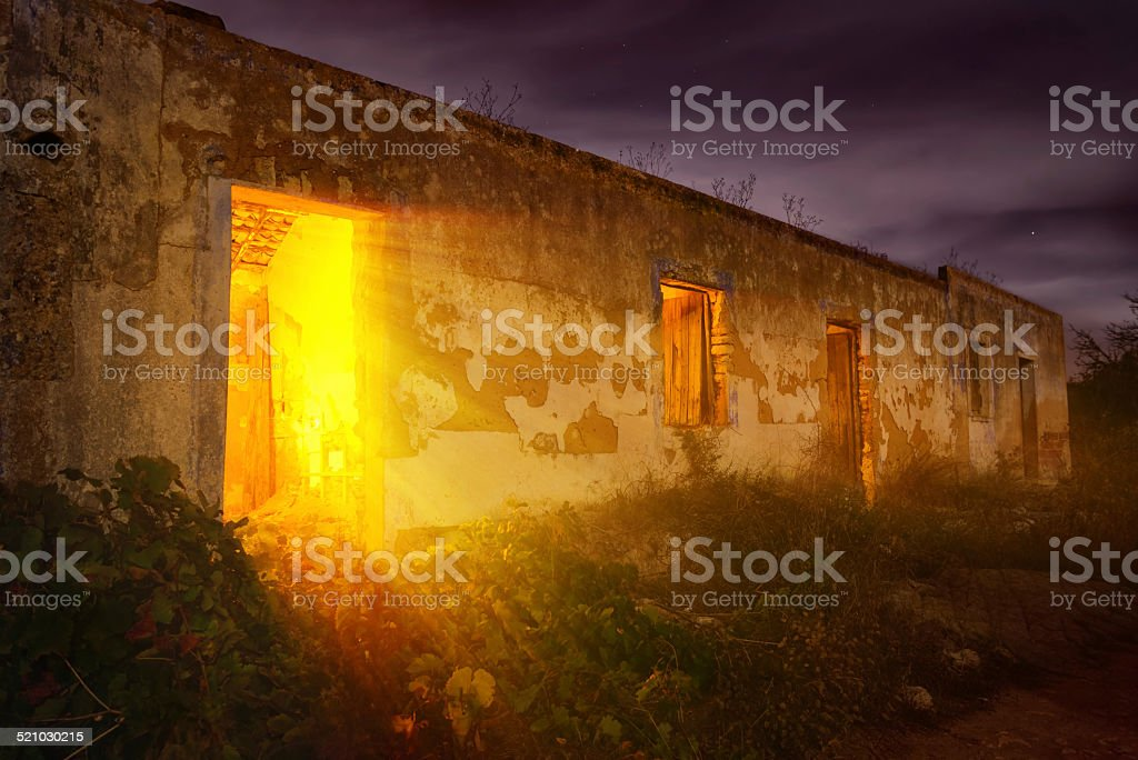 Mysterious light in abandoned house stock photo