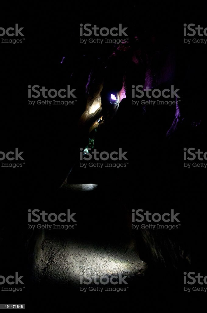 mysterious lights in cave stock photo