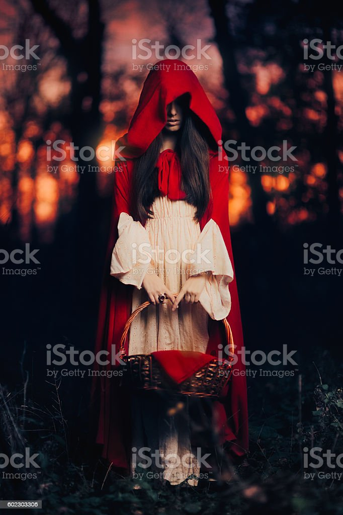 Mysterious Little Red Riding Hood in the Forest stock photo