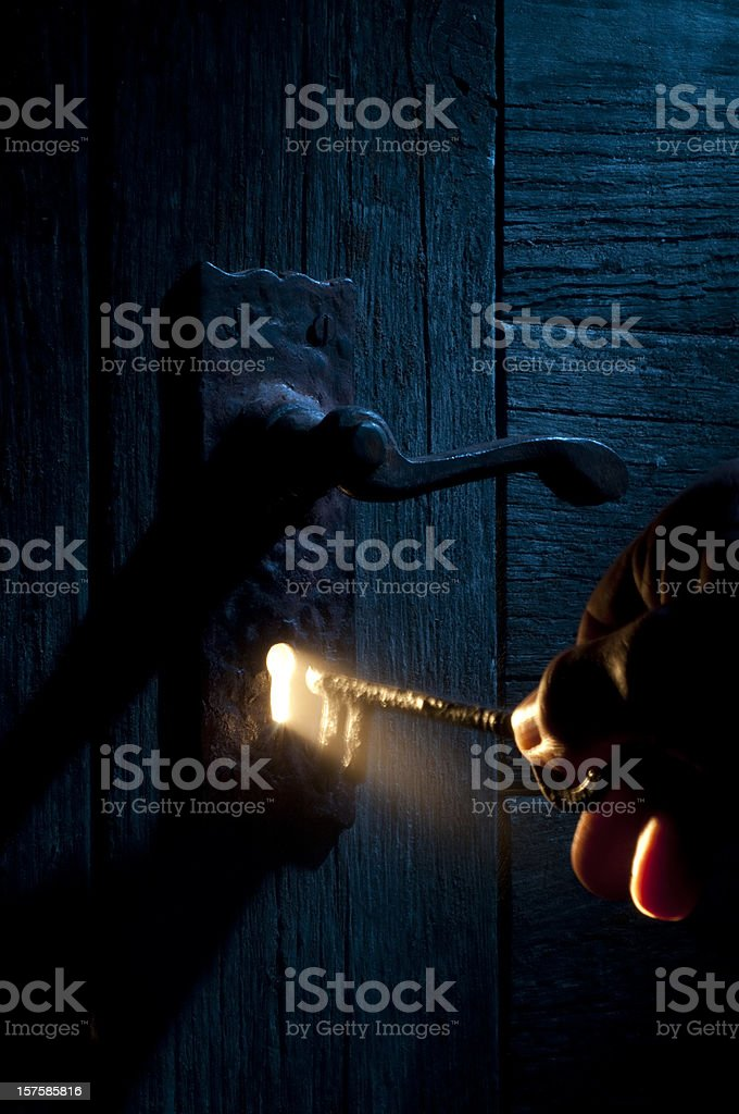 Mysterious Lock and key-light coming through keyhole stock photo