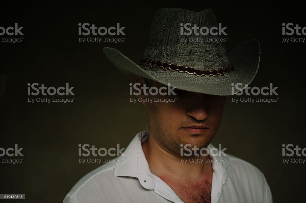 mysterious man in a cowboy hat stock photo