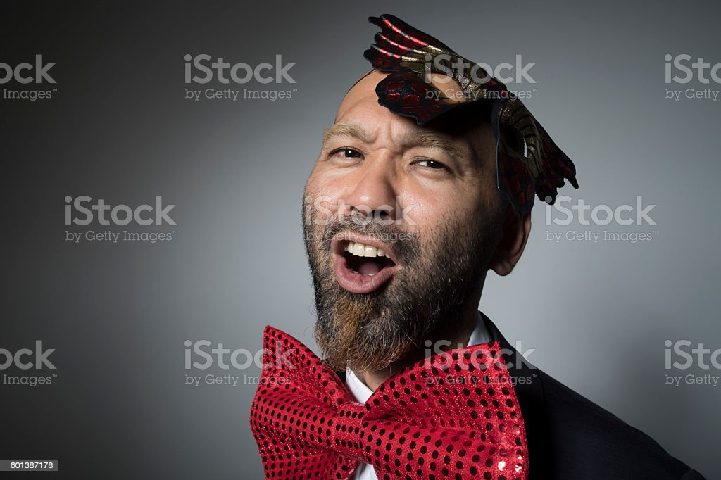 Mysterious man wearing a butterfly mask. stock photo