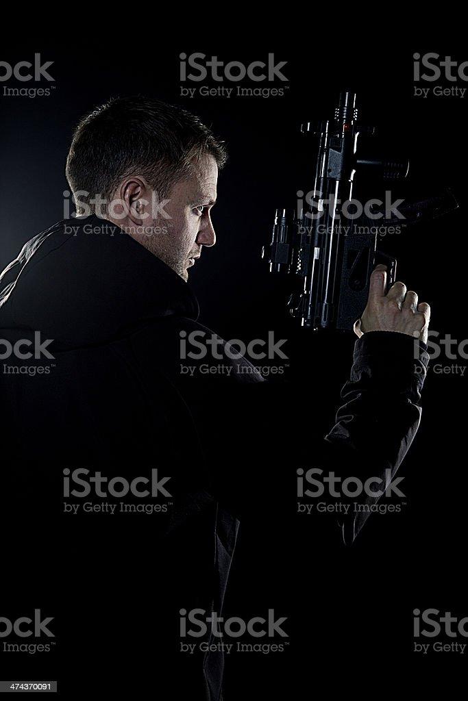 Mysterious man with gun stock photo