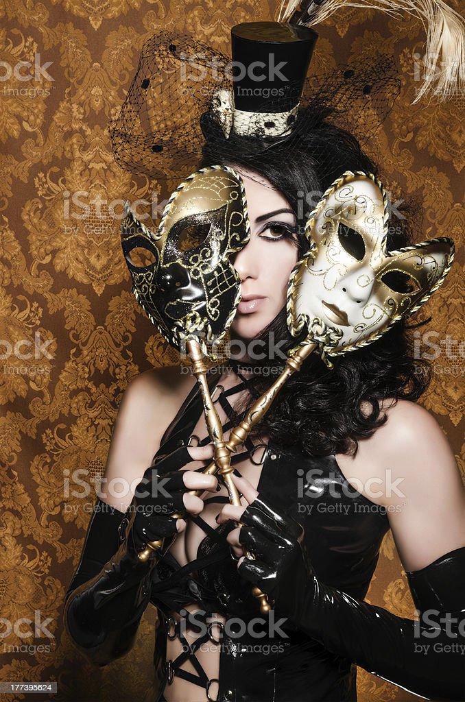 Mysterious Masquerade - Sexy Vixen with Venetian Masks royalty-free stock photo