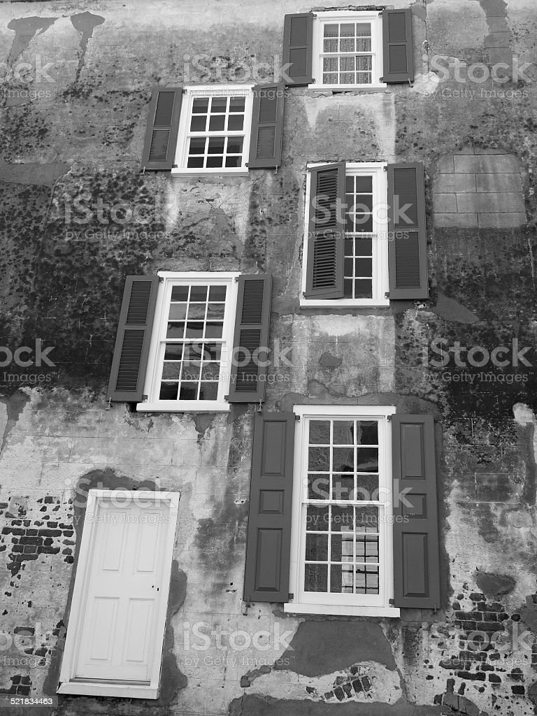 Mysterious, Maybe Haunted Building Exterior Windows, Shutters and a Door stock photo