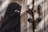 A mysterious Middle Eastern woman wearing a black Niqab