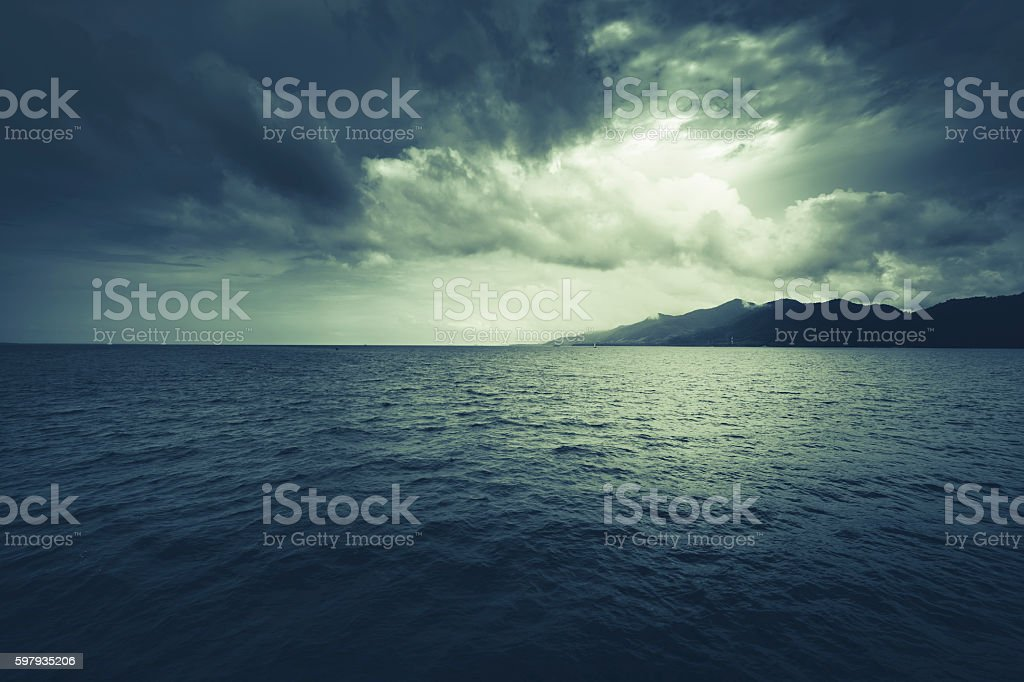 mysterious nightly clouds and mountain. stock photo