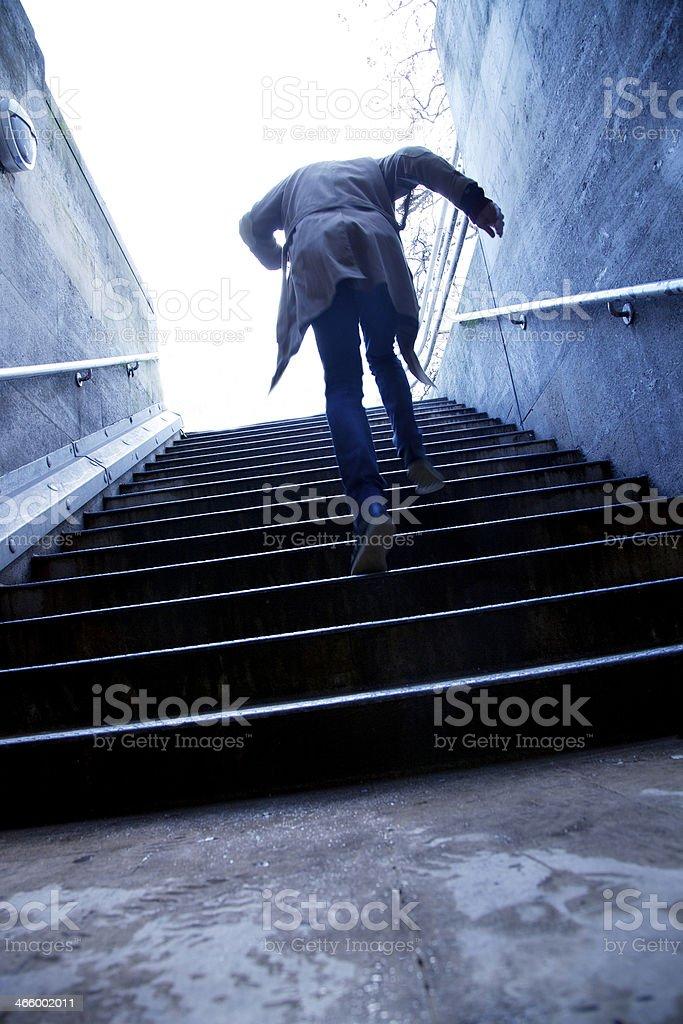 Mysterious running man stock photo