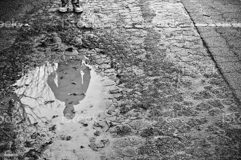 Mysterious Shadow of Man on a Puddle royalty-free stock photo