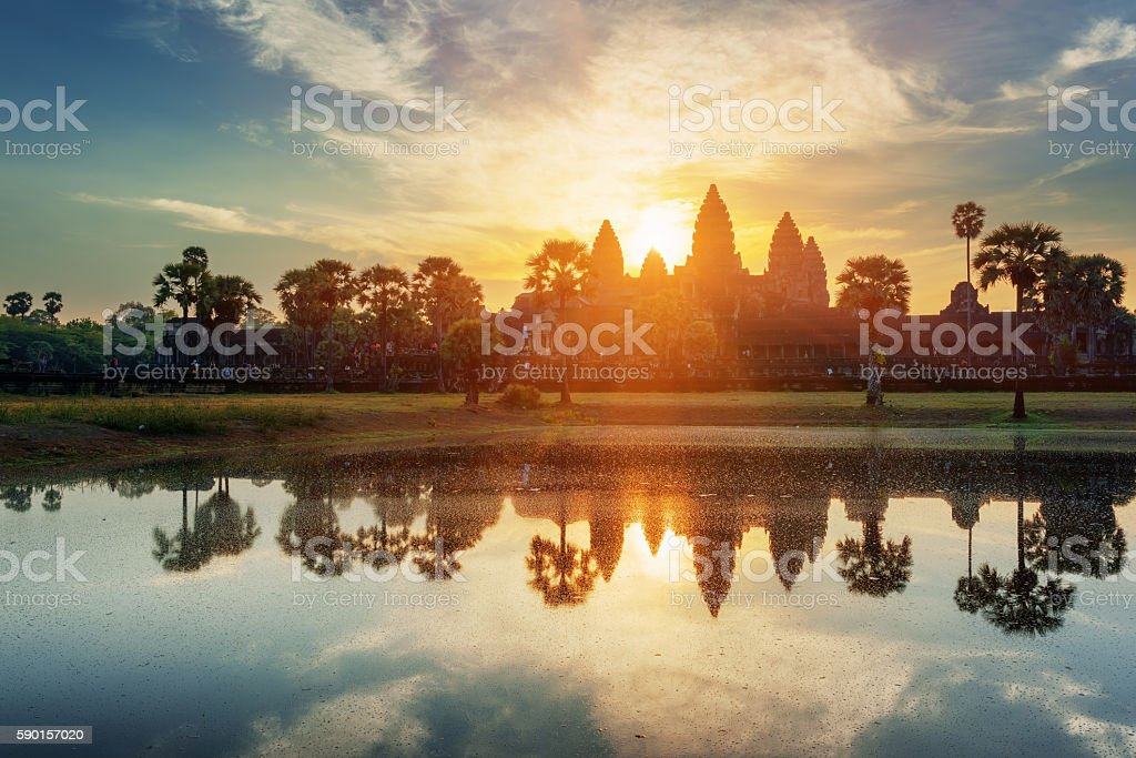 Mysterious towers of ancient Angkor Wat in Cambodia at dawn stock photo