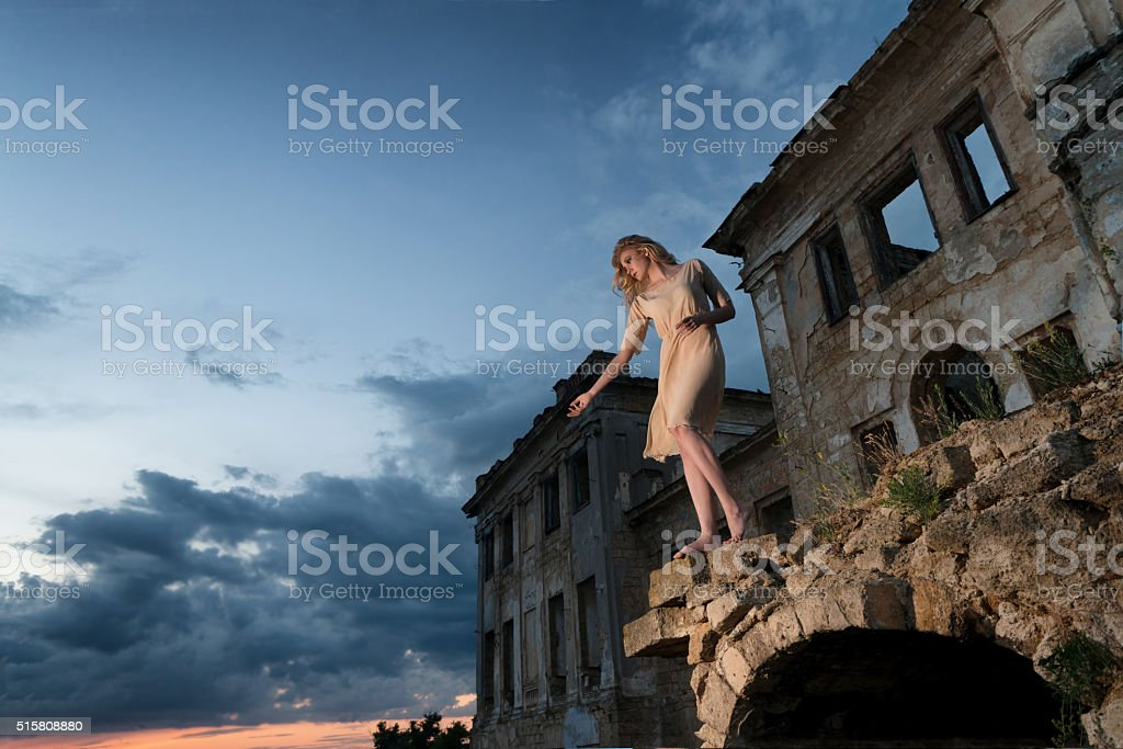 Mysterious woman in the ruins stock photo