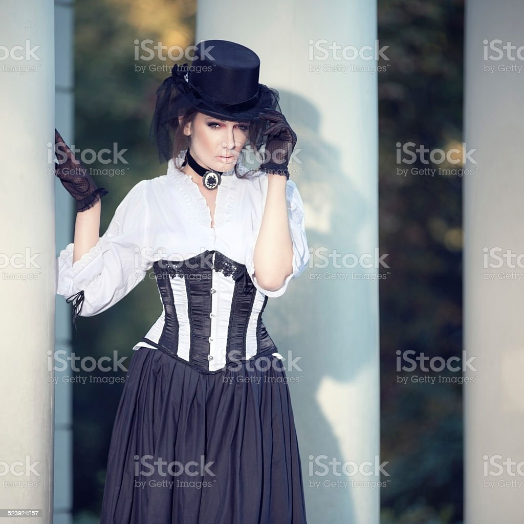 Mysterious woman in Victorian dress stock photo