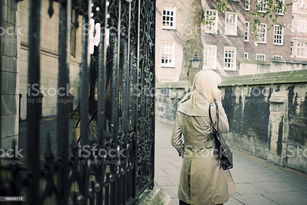 Mysterious Woman Speaking on Mobile Telephone stock photo