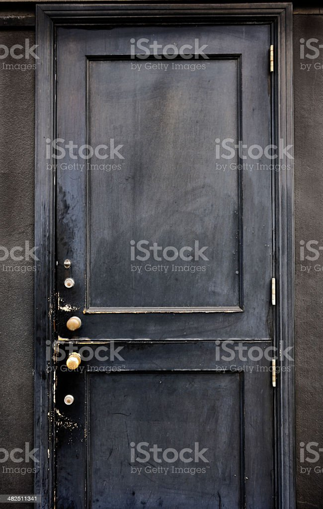 Mysterious wooden old black front door royalty-free stock photo