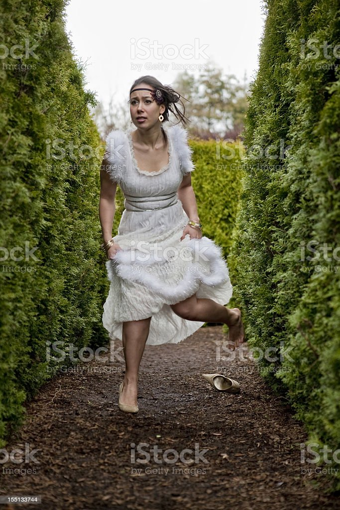 Mysterious Young  Woman in Gown ........ escaping into a Labyrinth royalty-free stock photo