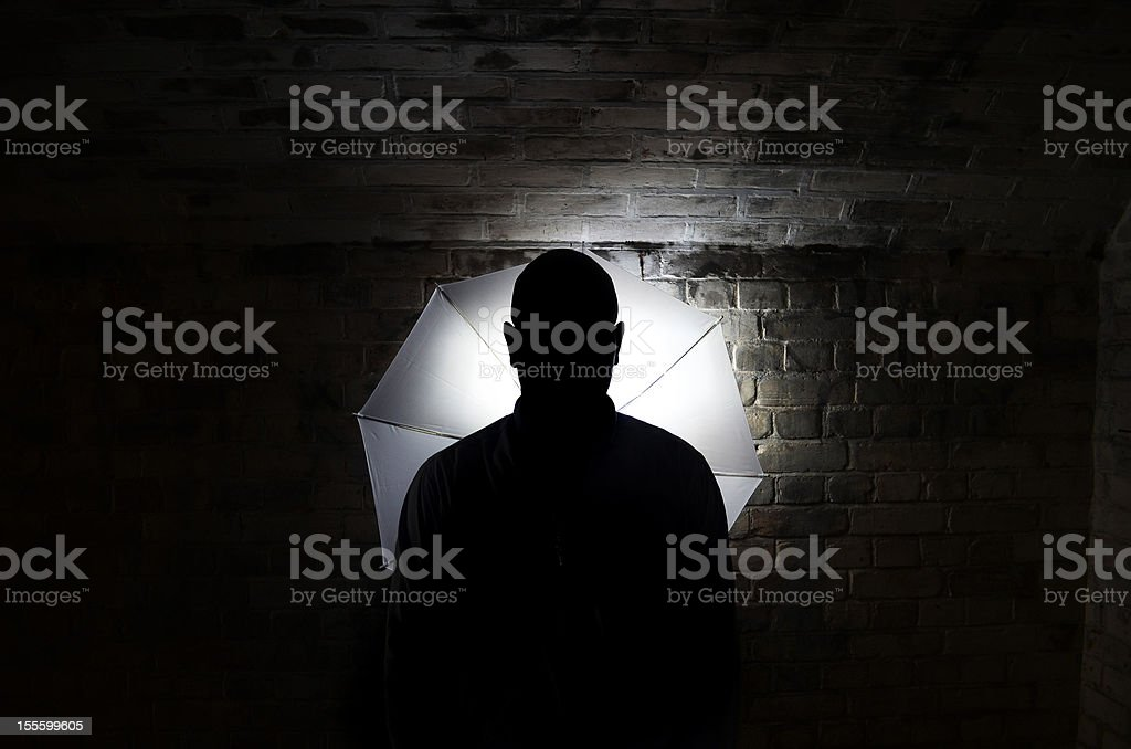 mystery person silhouette stock photo