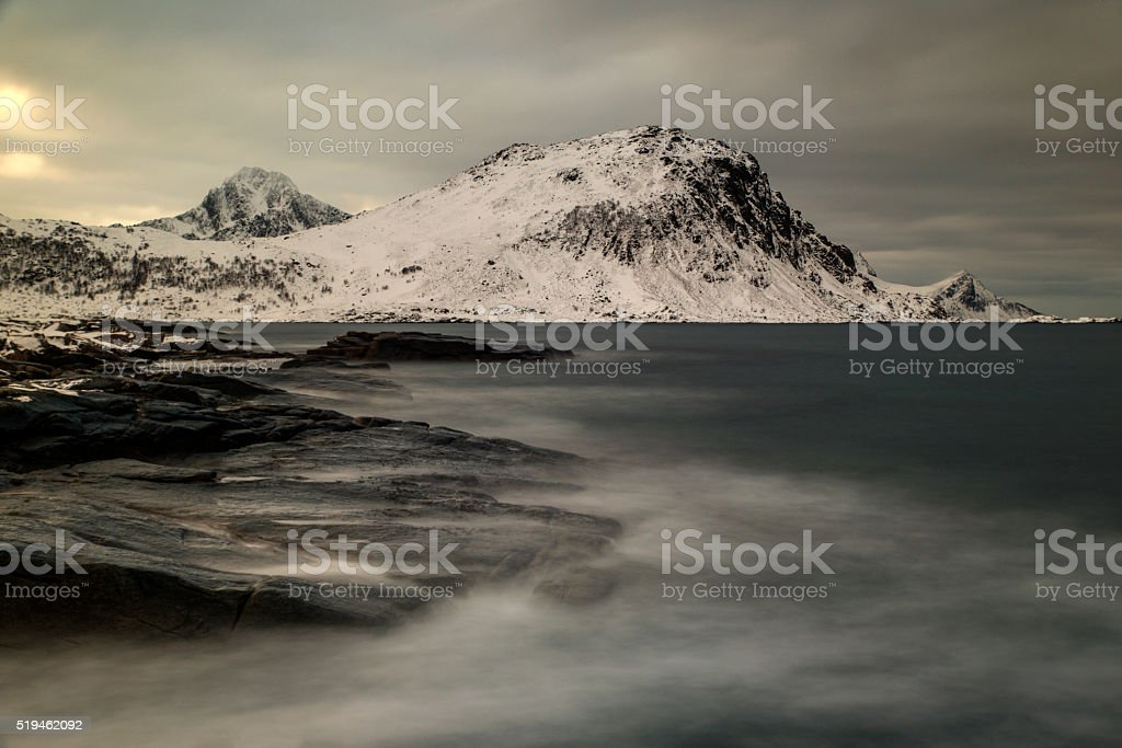 Mystic beach in winter at the nordic atlantic ocean stock photo