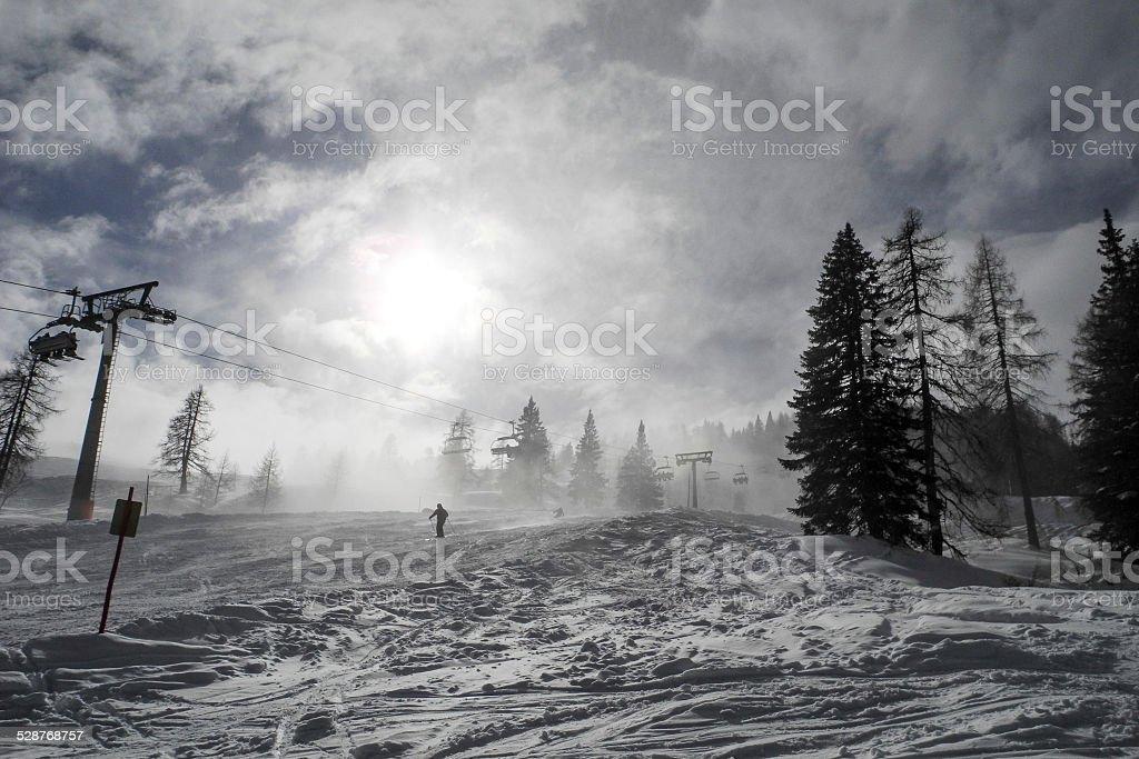 mystic ski slope in Austria in backlight stock photo