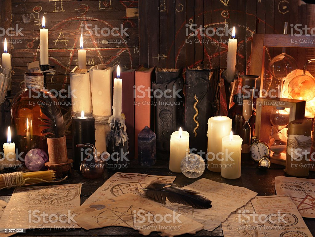 Mystic still life with magic objects, books and candles stock photo