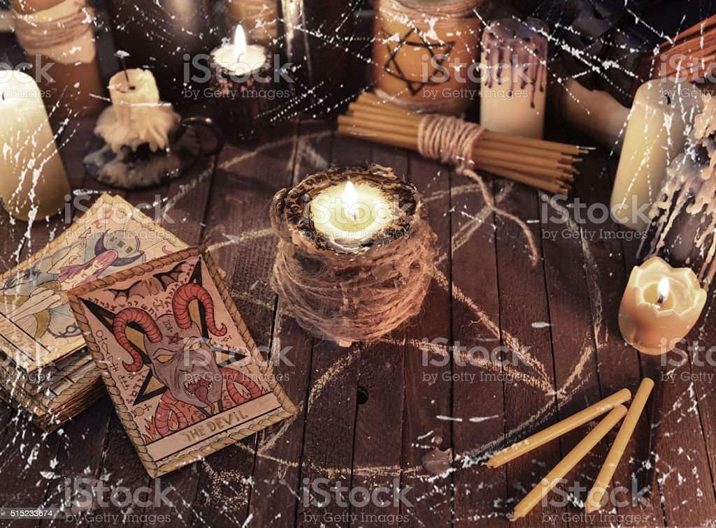 Mystic still life with tarot card and candles stock photo
