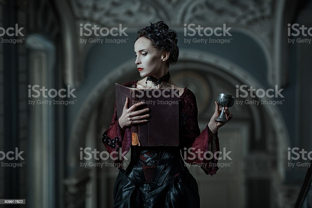 Mystic woman with book and cup in the Gothic style.
