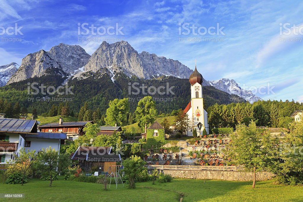 A mystical community with the view of Zugspitze in Germany stock photo