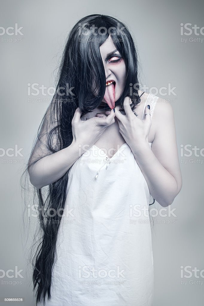 Mystical crazy woman showing long tongue stock photo