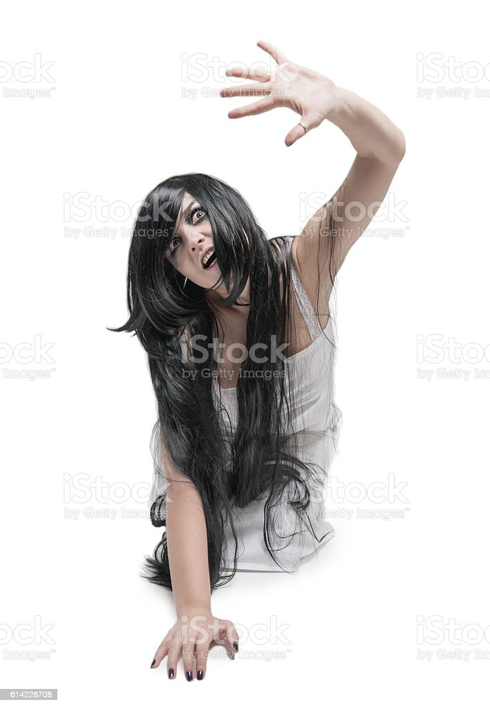 Mystical ghost woman in white long shirt stock photo
