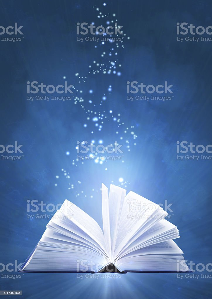 A mystical magical open book with glitter coming out royalty-free stock photo