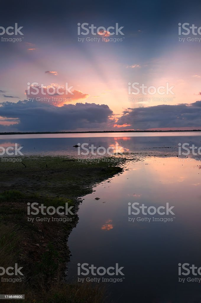 Mystical sun rays from a cloudy morning sky royalty-free stock photo