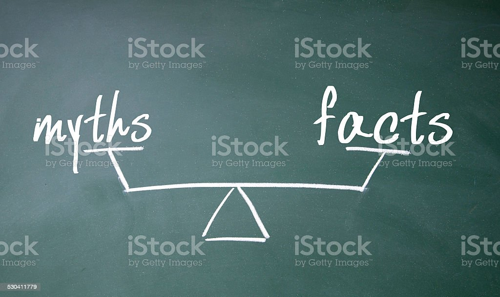 myths and facts balance sign stock photo