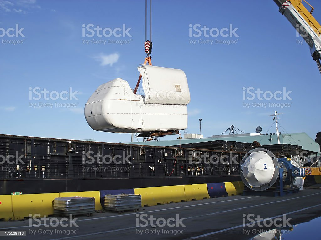Nacelle lifting from the ship stock photo