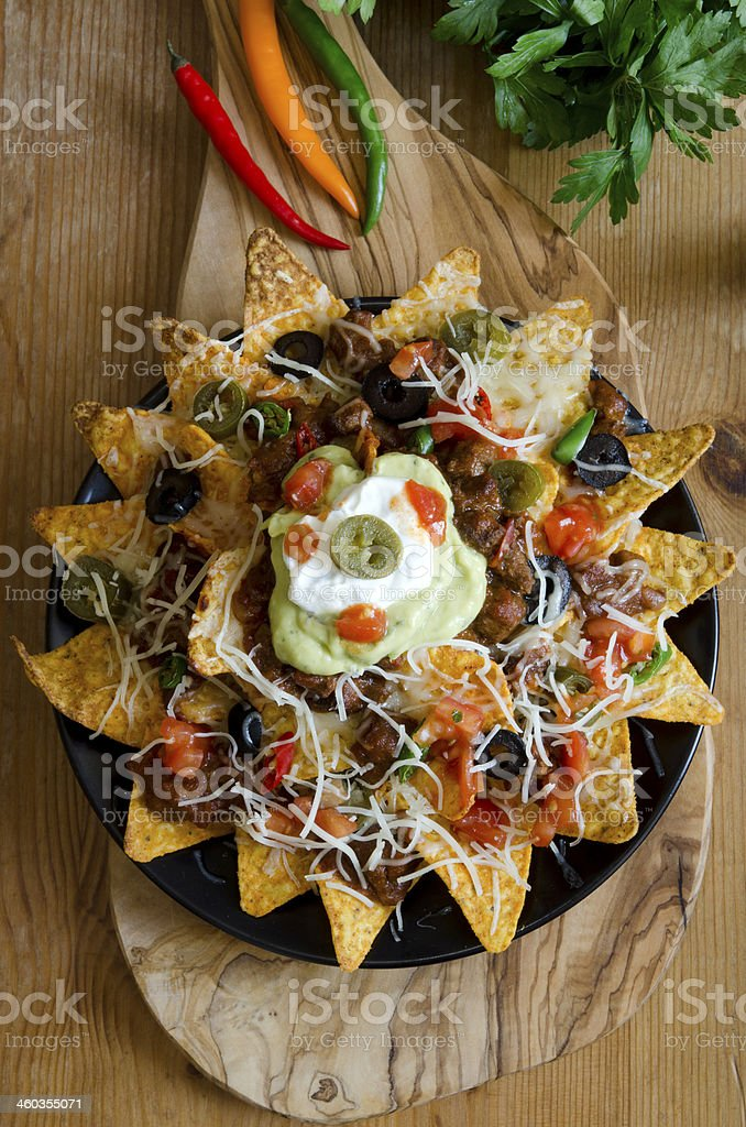 Nacho party platter on wood table stock photo