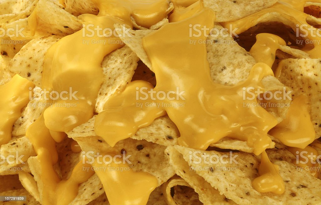 Nachos and Melted Cheese. stock photo