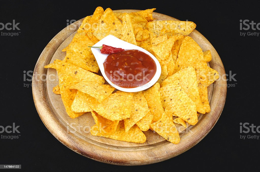nachos and salsa dip stock photo