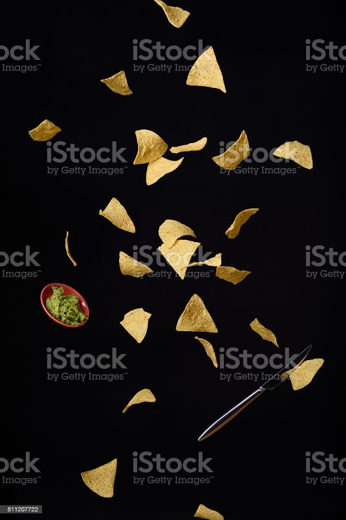 Nachos chips and guacamole, flying snack. stock photo